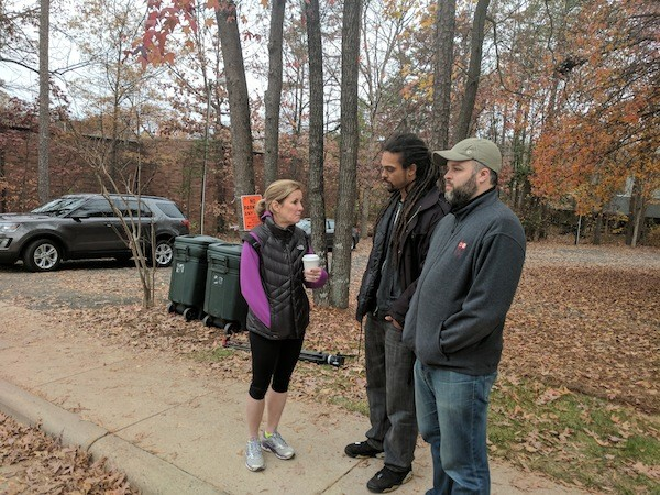 City council reps [from left] Julie Eiselt, Braxton Winston and Larken Egleston watch a Love Life Charlotte rally on December 2.