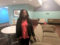 Tenille Banner in a common area at the Clyde and Ethel Dickson Domestic Violence Shelter. (Pitkin)