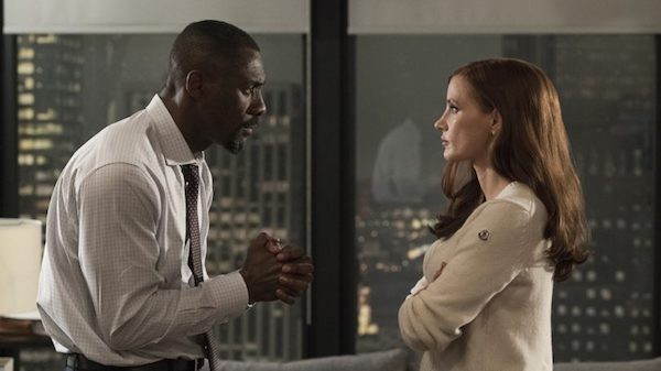 Idris Elba and Jessica Chastain in Molly's Game (Photo: Universal & STX)