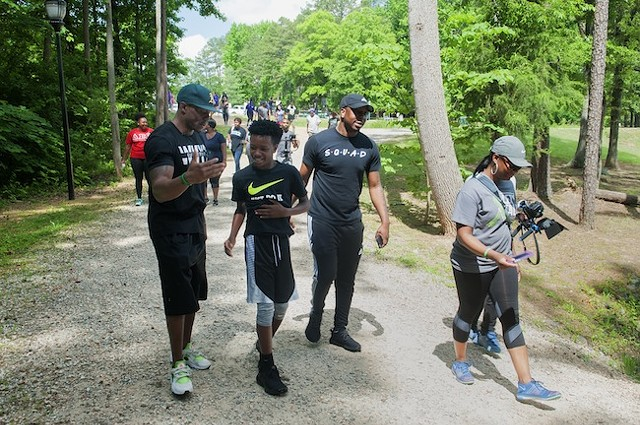 Miller [in green hat] and walkers at last year's Mental Health Awareness Walk at Park Road Park. (Photo by Jon Strayhorn)