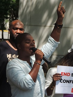 Brandy Hamilton speaks at a recent press conference in uptown Charlotte. (Photo by Ryan Pitkin)