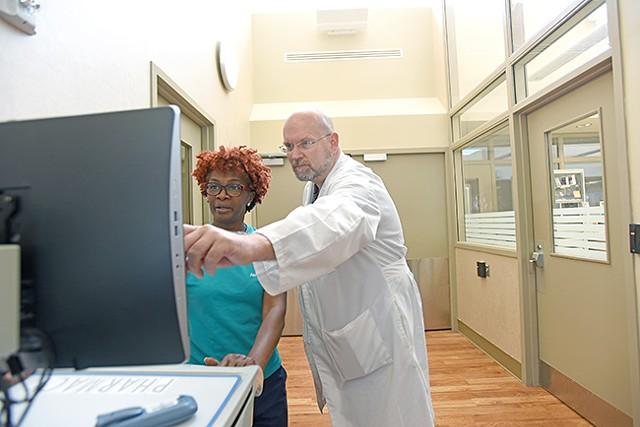 A psychiatrist speaks with a psychiatric nurse in the Atrium Behavioral Health Charlotte emergency department. (Photo courtesy of Atrium Health)