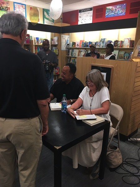 Belton Platt (sitting, left) with Pam Kelley at a recent signing at Park Road Books. (Photo by Betsy Thorpe)