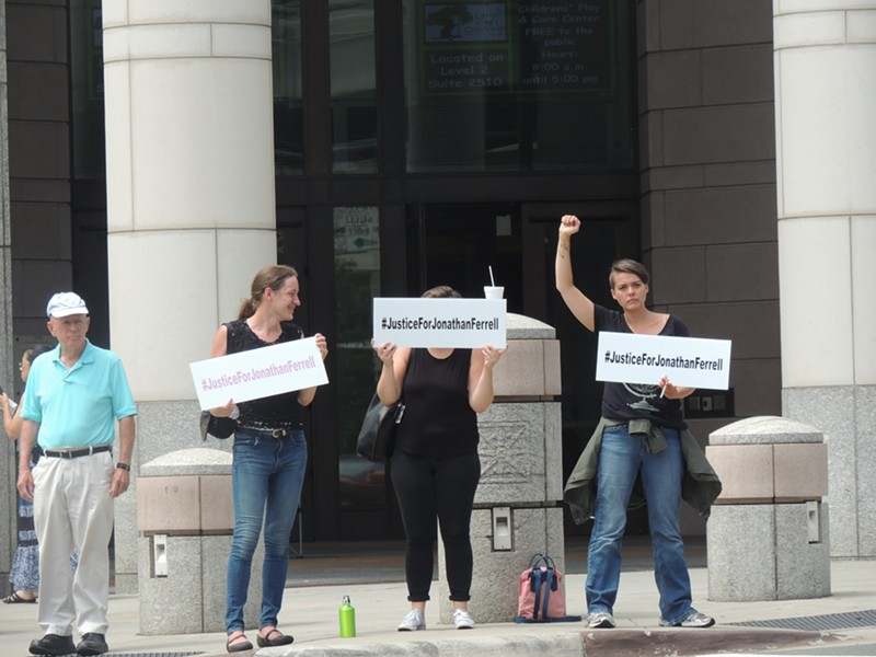 """Protestors stood outside the courthouse holding """"#JusticeForJonathan"""" signs following the announcement that the jury was deadlocked."""