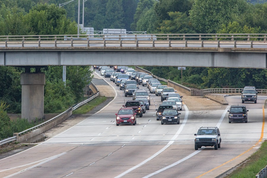 """Activists lead a """"funeral procession"""" on Brookshire Freeway, driving about 10 to 15 miles per hour to slow down traffic."""