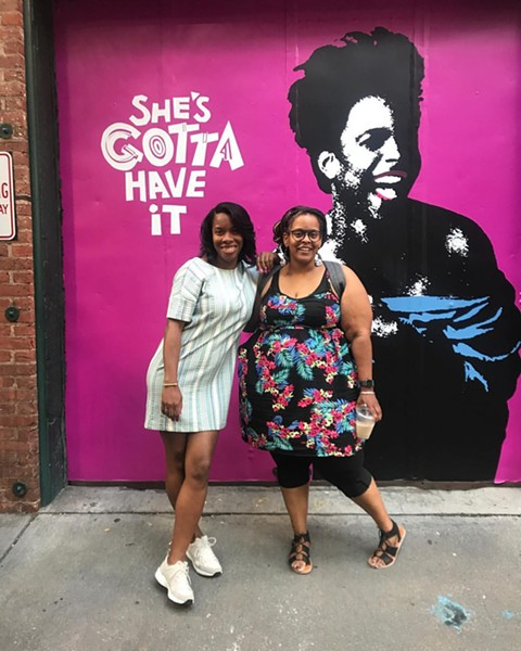 Rose (right) with Janelle Williamson of Spike Lee's 40 Acres staff.