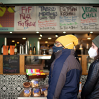 Owais Ahmed and Sophia Rafiqi of Chicago prepared to place a to-go order at Baba Nahm on November 17, 2020. The downtown Asheville restaurant's dining room remains closed. Colby Rabon / Carolina Public Press.