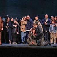 Lenore (Maria Katzarava) is acknowledged by the crowd for her heroism (Opera Carolina Chorus). (Photo by Jon Silla)