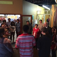 Mayor Dan Clodfelter and city council member Patsy Kinsey visit kids at the Behailu Academy, an arts-based youth center in NoDa.