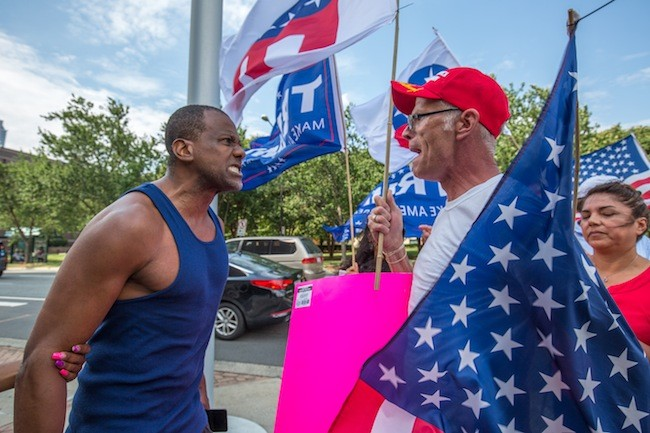 A man confronts Trump supporters in front of the Government Center. (photo by Grant Baldwin)