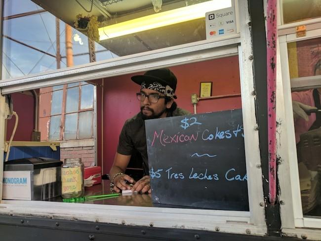 Garcia takes an order.
