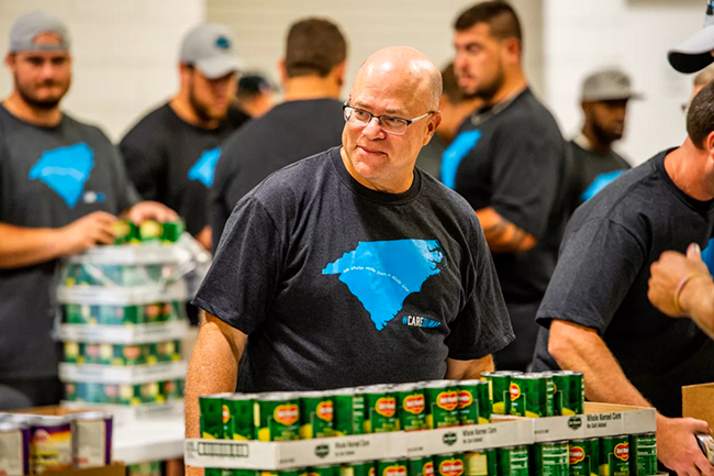 David Tepper joins the Panthers working for Hurricane Florence relief. (Photo by James Nix)