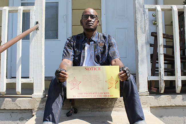 Alvin C. Jacobs Jr. outside of a home in Brookhill, where he shot his most recent exhibit. (Photo by Ryan Pitkin)