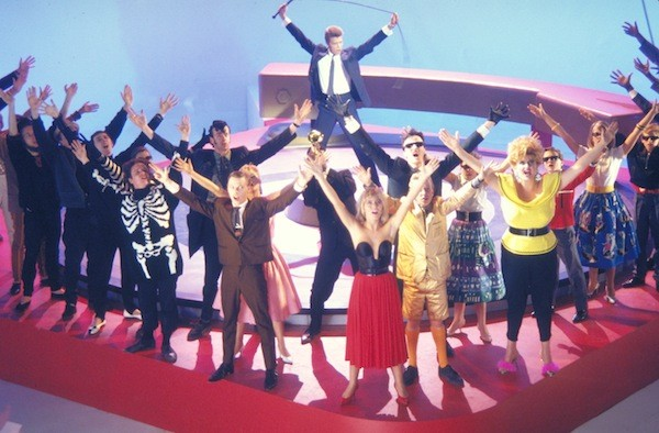 David Bowie (background) and Patsy Kensit (front center) in Absolute Beginners (Photo: Twilight Time)