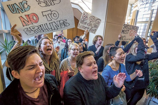 """About 100 students yelled chants like """"Margaret Spellings you can't hide, we can see your greedy side,"""" down the hall from a Dec. 11 UNC Board of Governors meeting. (Photo by Grant Baldwin)"""