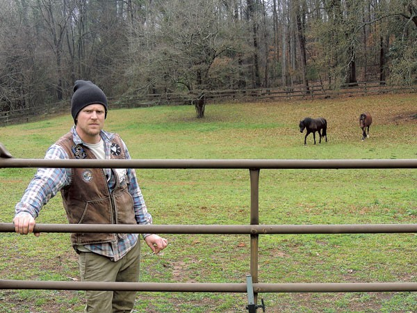 James Tyson on his farm in Southwest Charlotte. (Photo by Ryan Pitkin)