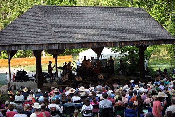 Fans gather around a side stage for the mandolin jam at MerleFest. - JEFF HAHNE