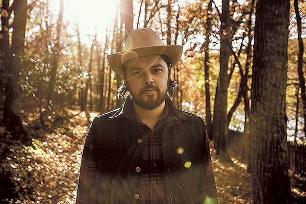 Caleb Caudle performs at The Evening Muse on June 25. (Photo by John Thatcher)