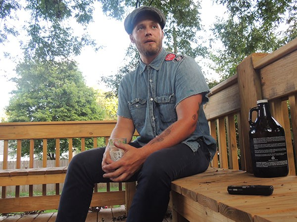 Will Puckett on the porch of his NoDa home the evening before leaving for Scotland.