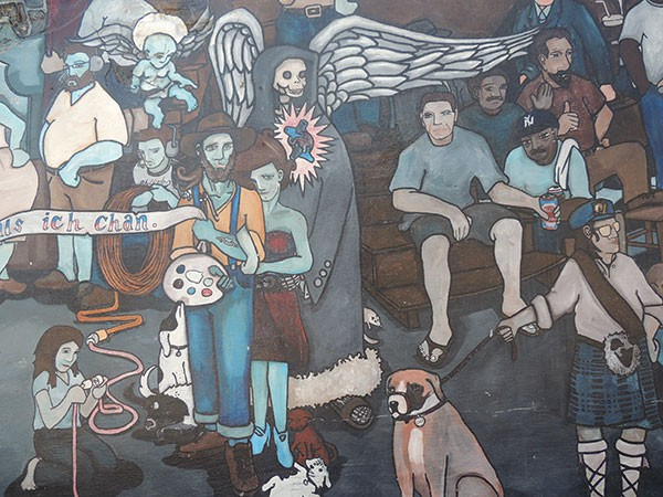 A close-up of the JackBeagle's wall mural, including Puckett's depiction of himself, his wife (in dress) and sister, Bobbie (kneeling with extension cord).