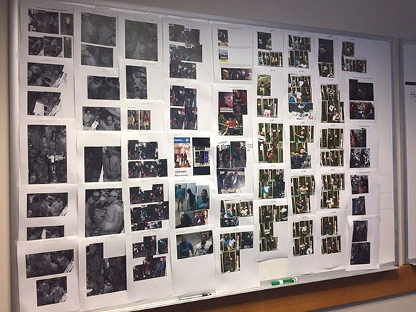 A wall of photos being used by those investigating looting and vandalism cases during unrest following the Keith Lamont Scott killing were taken from surveillance video, news footage and social media feeds.