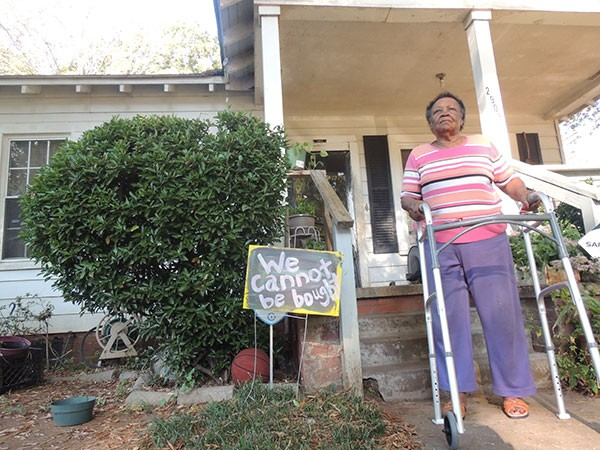 Martha McAfee stands outside of her Enderly Park home.