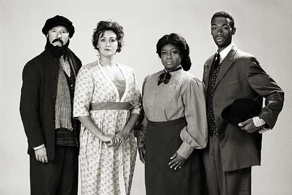Billy Ensley, as Tateh (from left); Lucia Stetson, as Mother; Brittaney Currie, as Sarah; Tyler Smith, as Coalhouse.