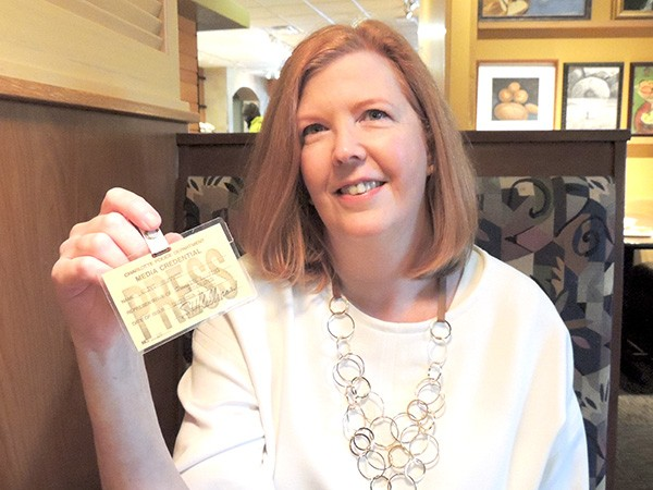 Olivia Fortson with her first press badge, issued in 1989.