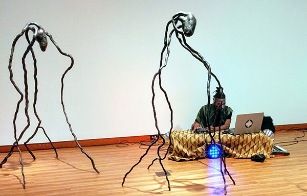 Maf Maddix works near an Alison Saar sculpture. Photo by Steven Danan.