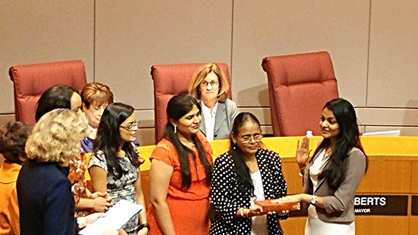 Dimple Ajmera (far right) stands with family as she's sworn in as District 5 representative in January.