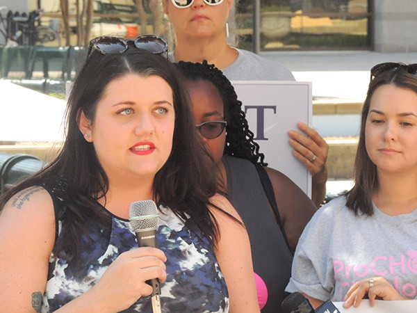 Calla Hales speaks at a recent press conference in which she and others called on the city to help mitigate extreme tactics used by protesters outside of abortion clinics in Charlotte. (Photo by Ryan Pitkin)