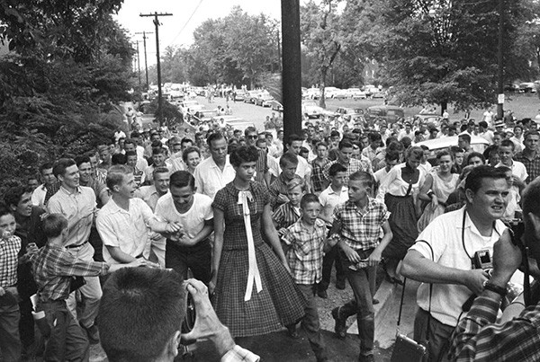Dorothy Counts, 15, walks to school among a seething crowd of white students and parents on September 4, 1957. (Photo courtesy of Charlotte Observer)