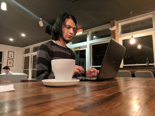 Carlos Miranda sits inside Summit Coffee on the Davidson College campus.