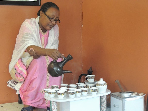 Shito Negussie pours coffee during one of her daily ceremonies.