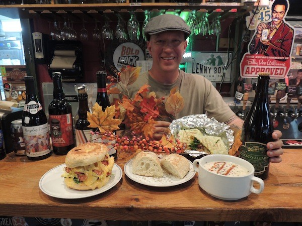 Common Market owner Blake Barnes with some of the food he'll be offering up on Thanksgiving. (Photo by Ryan Pitkin)