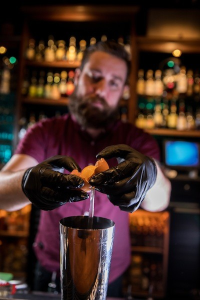 Kel Minton has a cocktail inspired by his grandfather's penchant for cigarettes and scotch. (Photo by Peter Taylor)