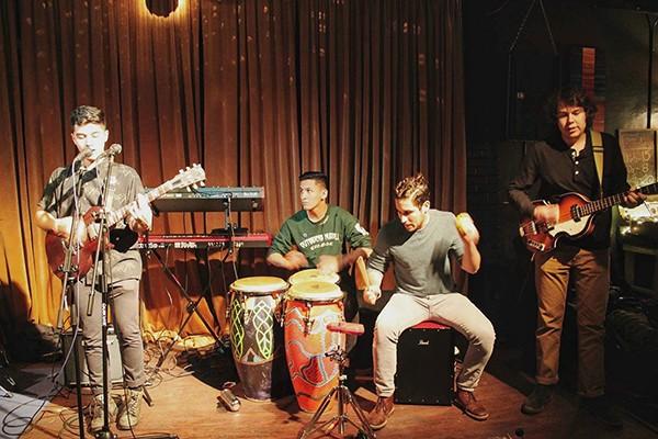 Quisol (from left) with band members Michael David Gonzalez, Randall Davis and Nikolas Maldonado. (Photo by Lex Paige)