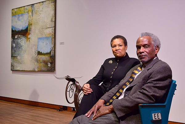 """The Diamonds sit in seats pulled from the old Charlotte Colisuem and repurposed by local artist Ben Parrish. Behind them is Cheryl Warrick's """"No Wealth but Life."""""""