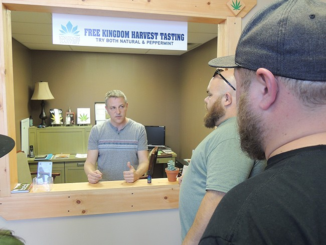 [From left] Carolina Hemp Company owner Randall Snyder talks to Michael Sims and Dan Hentschke, founders of Charlotte CBD.
