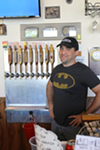 Owner Brad Ledbetter stands next to the taps available at Thirsty Nomad Brewing. (Photo by Courtney Mihocik)