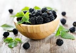 Blackberries in a wooden bowl - Uploaded by ajnewso2