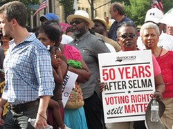 On July 13, residents rallied in Winston Salem to support the plaintiffs in a voter suppression lawsuit being tried there that challenges the passage of North Carolina House Bill 589. (Photo courtesy of Advancement Project)