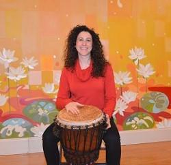 0f7a11b7_elizabeth_drumming_kirtan.jpg