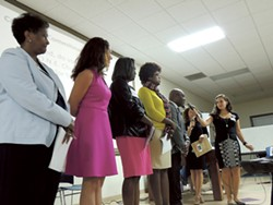 School board candidates line up at a commitment forum hosted by O.N.E. Charlotte, at which they promised to focus on issues prioritized by community members weeks prior. (Photos by Ryan Pitkin)