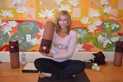 2ae61ab7_chrys_kub_yoga_instructor_rolleasana.jpg