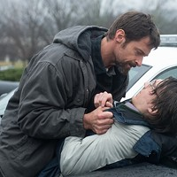 UNDER SUSPICION: Keller (Hugh Jackman) tries to beat a confession out of Alex (Paul Dano) in Prisoners. (Photo: Warner Bros.)