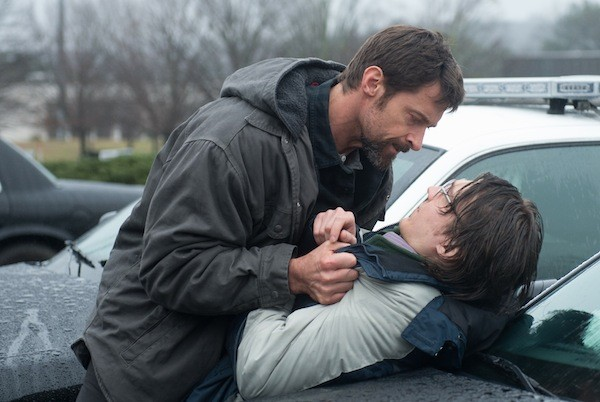 UNDER SUSPICION: Keller (Hugh Jackman) tries to beat a confession out of Alex (Paul Dano) in Prisoners. (Photo: Warner Bros.)