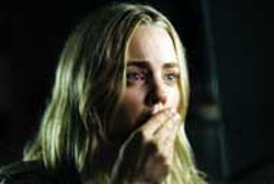 PETER IOVINO / MGM & DIMENSION - UNSPEAKABLY AWFUL Melissa George reacts to The - Amityville Horror