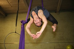 JEFF HAHNE - UP IN THE AIR: Maggie Kingsley hangs from the silks.