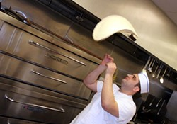 CATALINA KULCZAR - Upstate Pizza owner Roman Sarkisyan tosses a palatable pie.